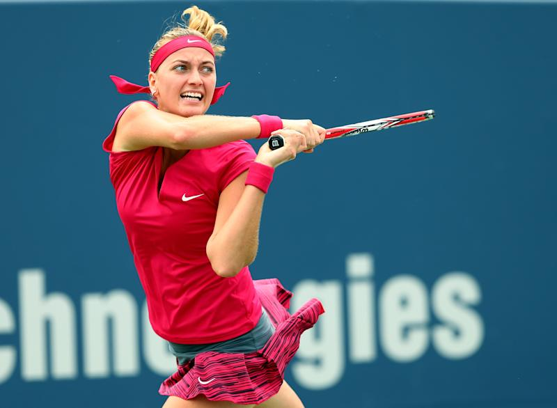 Petra Kvitova of the Czech Republic returns a shot to Barbora Zhlavova Strycova of the Czech Republic during the Connecticut Open on August 21, 2014 in New Haven