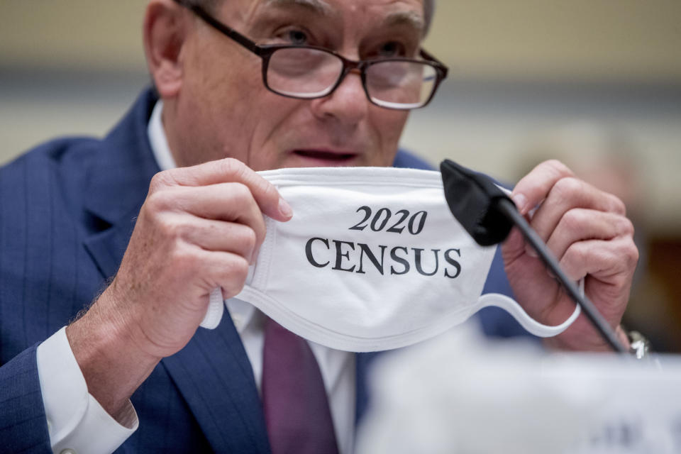 """Census Bureau Director Steven Dillingham holds up his mask with the words """"2020 Census"""" as he testifies before a House Committee on Oversight and Reform hearing on the 2020 Census on Capitol Hill, Wednesday, July 29, 2020, in Washington. (AP Photo/Andrew Harnik)"""