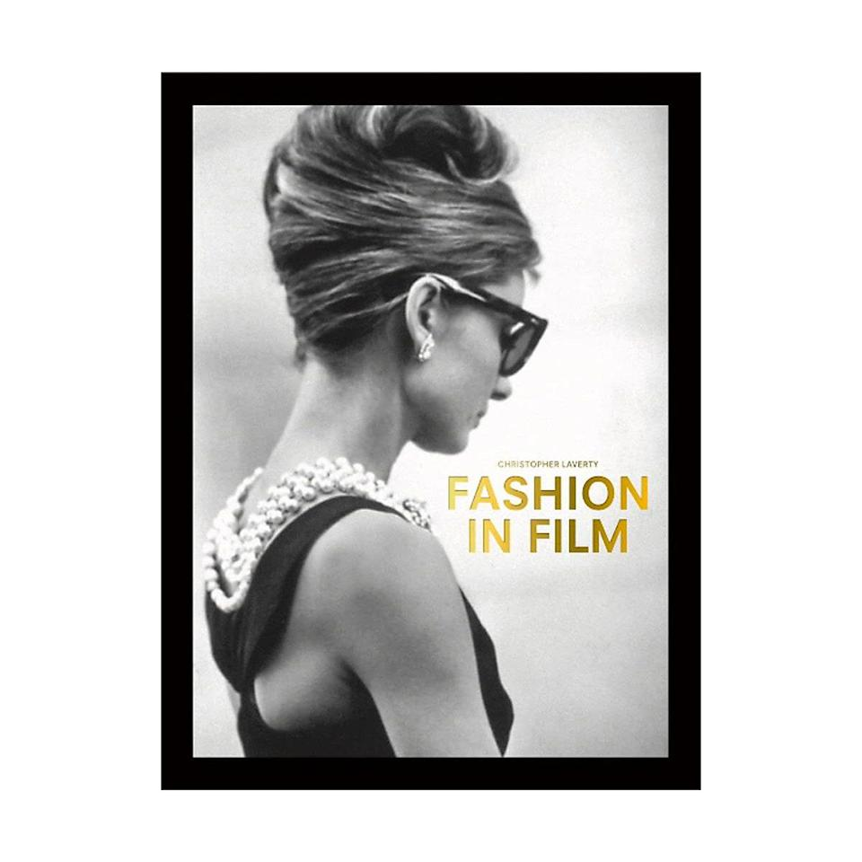 """Fashion historians and cinephiles will be obsessed with the pocket edition of this coffee-table book, which unpacks some of the greatest looks from the silver screen. $17, Amazon. <a href=""""https://www.amazon.com/Fashion-Pocket-Editions-Christopher-Laverty/dp/1786277093/"""" rel=""""nofollow noopener"""" target=""""_blank"""" data-ylk=""""slk:Get it now!"""" class=""""link rapid-noclick-resp"""">Get it now!</a>"""
