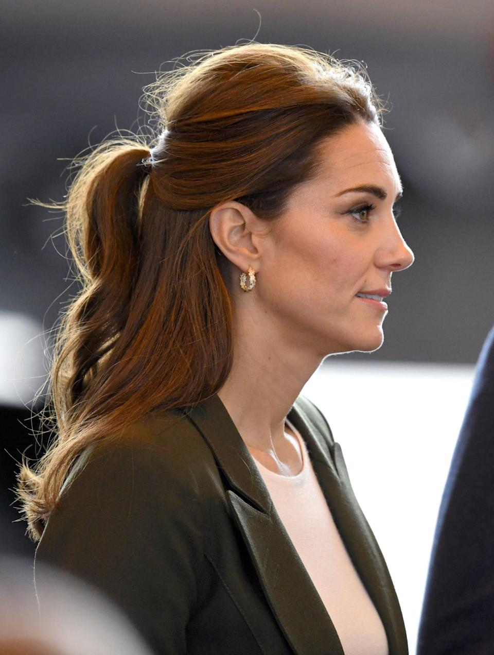 <p>For a royal visit in Cyprus, Middleton wore her hair in a half-up ponytail. And while the style is less pristine and polished than we're use to seeing from the Duchess, it's still clear she's had a smooth blowout beforehand. </p>