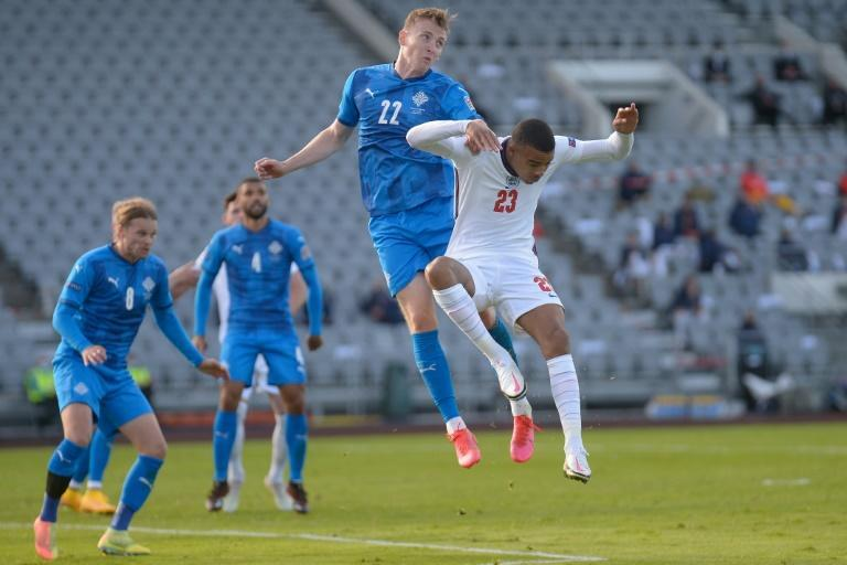 Air force: England's Mason Greenwood and Iceland's Jon Bodvarsson challenge for the ball