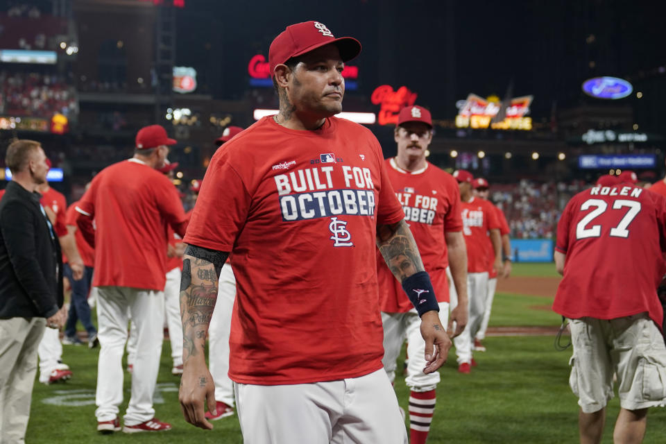 St. Louis Cardinals catcher Yadier Molina celebrates with teammates after defeating the Milwaukee Brewers in a baseball game to clinch a playoff spot Tuesday, Sept. 28, 2021, in St. Louis. (AP Photo/Jeff Roberson)