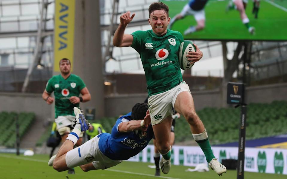 Italy's Carlo Canna fails to stop Ireland's Hugo Keenan as he runs towards the line to score a try during the Six Nations rugby union international match between Ireland and Italy at the Aviva Stadium in Dublin, Ireland, Saturday, Oct. 24, 2020.  - AP