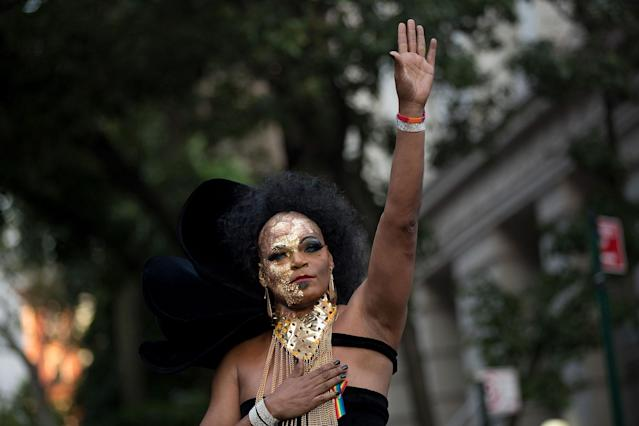 <p>Anthony LaMont waves to the crowd after singing a song during a memorial service and rally for the victims of the 2016 Pulse nightclub shooting, down the street from the historic Stonewall Inn June 12, 2017 in New York City. Monday marks the one year anniversary of the Pulse nightclub shooting in Orlando, Florida that killed 49 people. (Photo: Drew Angerer/Getty Images) </p>