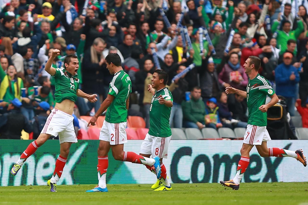 MEXICO CITY, MEXICO - NOVEMBER 13: Paul Aguilar of Mexico celebrates with his teammates during a match between Mexico and New Zealand as part of the FIFA World Cup Qualifiers at Azteca Stadium on November 13, 2013 in Mexico City, Mexico. (Photo by Hector Vivas/Getty Images)
