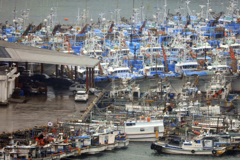 In this Sunday, Sept. 22, 2019, photo, fishing boats are anchored at a port as Typhoon Tapah approaches Jeju Island, South Korea. The powerful typhoon has battered southern South Korea after lashing parts of Japan's southern islands with heavy rains and winds. (Park Ji-ho/Yonhap via AP)