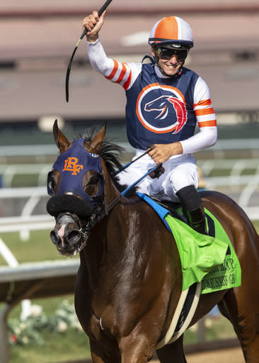 In a photo provided by Benoit Photo, jockey Flavien Prat guides Fashion Business to the winner's circle after their victory in the Grade II, $250,000 Del Mar Handicap horse race Saturday, Aug. 18, 2018, at Del Mar Thoroughbred Club in Del Mar, Calif. (Benoit Photo via AP)