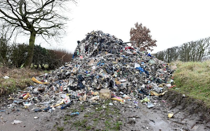 Huge amount of flytipping down a country lane in Staffordshire - Credit: Caters
