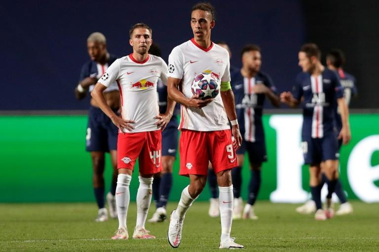 RB Leipzig's Danish striker Yussuf Poulsen (C) shows his disappointment at their Champions League defeat to Paris Saint Germain in the semi-finals on Tuesday.