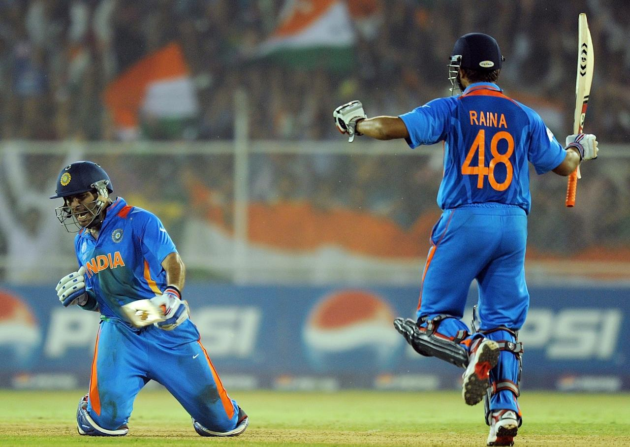 Indian batsman Yuvraj singh (L) and teammate Suresh Raina celebrates after beating Australia during the quarter-final match of The ICC Cricket World Cup 2011 between India and Australia at The Sardar Patel Stadium, Motera in Ahmedabad on March 24, 2011. India beat Australia by five wickets.  AFP PHOTO/MANAN VATSYAYANA (Photo credit should read MANAN VATSYAYANA/AFP/Getty Images)