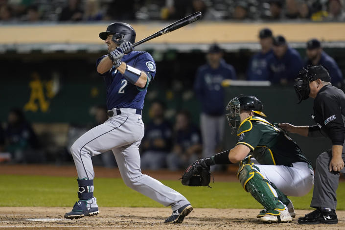 Seattle Mariners' Tom Murphy hits an RBI-single in front of Oakland Athletics catcher Sean Murphy during the fourth inning of a baseball game in Oakland, Calif., Wednesday, Sept. 22, 2021. (AP Photo/Jeff Chiu)