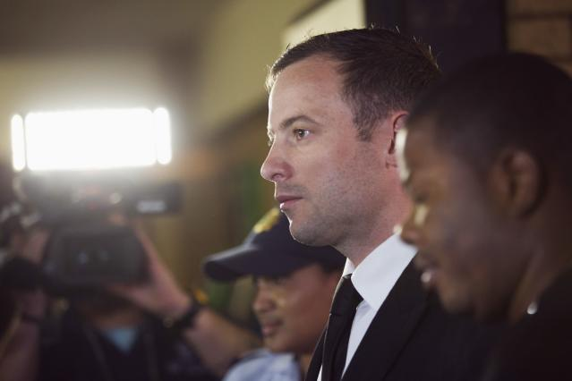 """South African Olympic and Paralympic track star Oscar Pistorius arrives at the North Gauteng High Court in Pretoria, September 12, 2014. Pistorius returned to court on Friday after being cleared of murdering girlfriend Reeva Steenkamp, but the South African Olympic and Paralympic sprinter could still be convicted of culpable homicide for the """"negligent"""" shooting of the model. REUTERS/Rogan Ward (SOUTH AFRICA - Tags: SPORT ATHLETICS CRIME LAW)"""