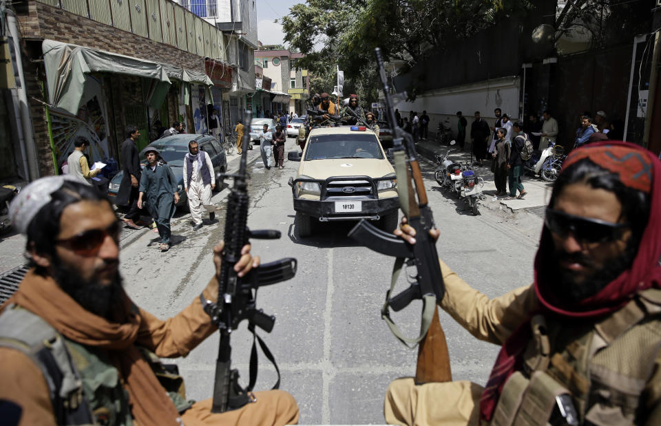 Taliban fighters patrol Kabul, Afghanistan, Thursday, Aug. 19, 2021. The Taliban celebrated Afghanistan's Independence Day on Thursday by declaring they beat the United States, but challenges to their rule ranging from running a country severely short on cash and bureaucrats to potentially facing an armed opposition began to emerge. (AP Photo/Rahmat Gul)