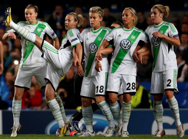 FILE PHOTO: Wolfsburg's Zsanett Jakabfi (2nd L) reacts in the wall during their women's UEFA Champions League final against Olympique Lyon in London.