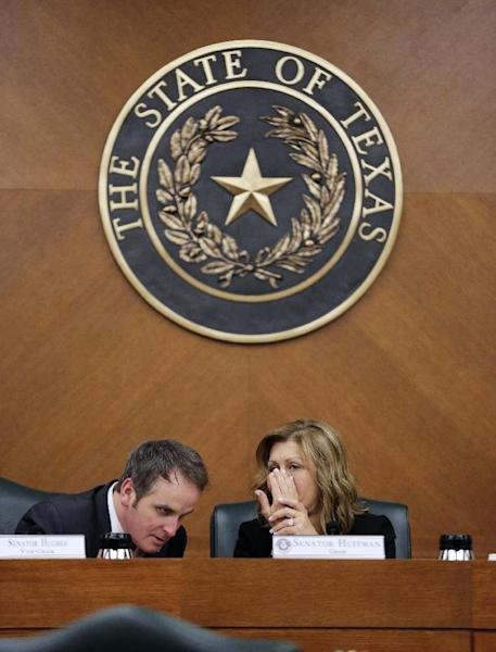 "Texas Sen. Bryan Hughes, R-Mineola, and Sen. Joan Huffman, R-Houston, talk as the Senate State Affairs Committee begins debate Senate Bill 6 at the Texas Capitol, Tuesday, March 7, 2017, in Austin, Texas. The the transgender ""bathroom bill"" would require people to use public bathrooms and restrooms that correspond with the sex on their birth certificate. (AP Photo/Eric Gay)"