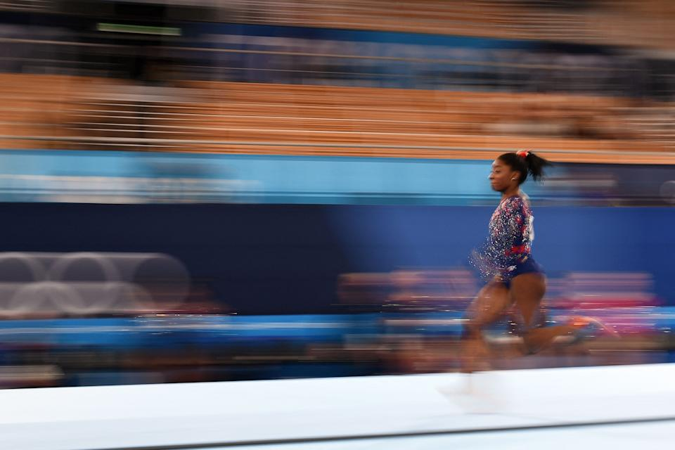 <p>USA's Simone Biles competes in the artistic gymnastics vault event of the women's qualification during the Tokyo 2020 Olympic Games at the Ariake Gymnastics Centre in Tokyo on July 25, 2021. (Photo by Martin BUREAU / AFP) (Photo by MARTIN BUREAU/AFP via Getty Images)</p>