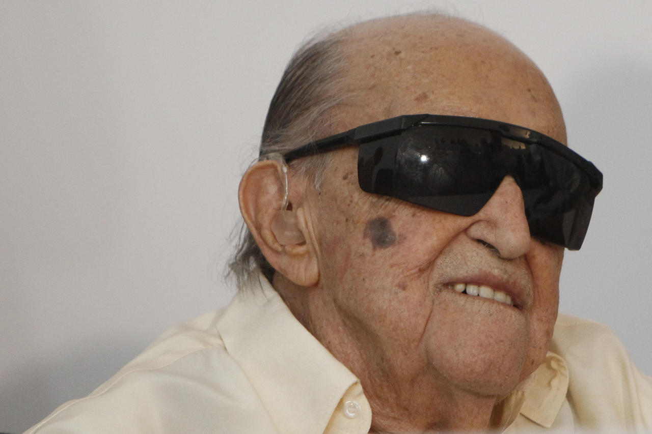 Brazilian architect Oscar Niemeyer attends on his 103 birthday the inauguration of the Oscar Niemeyer foundation building in Niteroi, Brazil, Wednesday Dec. 15, 2010.