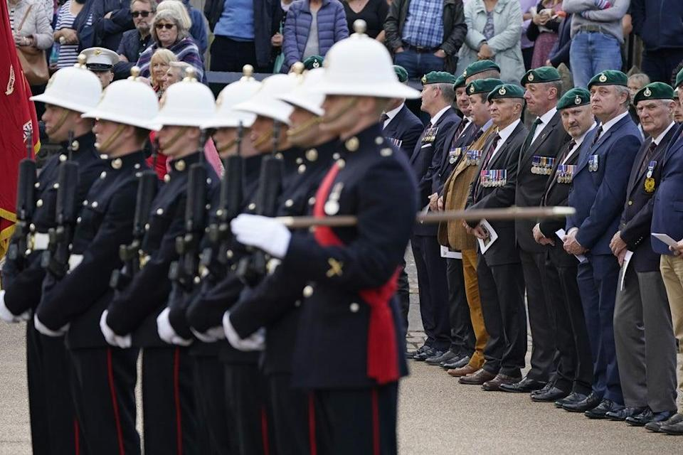 Veterans gather behind a detachment of Royal Marines outside Winchester Cathedral (Andrew Matthews/PA) (PA Wire)