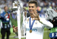 FILE - In this Saturday, May 26, 2018 file photo Real Madrid's Cristiano Ronaldo celebrates with the trophy after winning the Champions League Final soccer match between Real Madrid and Liverpool at the Olimpiyskiy Stadium in Kiev, Ukraine. Neither Lionel Messi nor Cristiano Ronaldo will be in the Champions League quarterfinals for the first time since 2005. The two greatest players of the current generation were both eliminated from the competition this week. Messi scored a goal but missed a penalty as Barcelona was eliminated by Paris Saint-Germain. Ronaldo and his Juventus teammates were ousted by Porto the night before. Ronaldo has won five Champions League titles in his career. Messi has won four. (AP Photo/Pavel Golovkin, File)