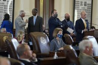 Texas State lawmakers line up to question Texas State Rep. Andrew Murr as they debate voting bill SB1 in the House Chamber at the Texas Capitol, Thursday, Aug. 26, 2021, in Austin, Texas. (AP Photo/Eric Gay)