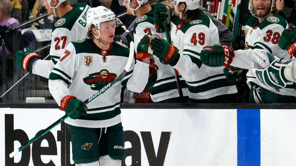 LAS VEGAS, NEVADA - MAY 28: Kirill Kaprizov #97 of the Minnesota Wild celebrates with teammates on the bench after scoring a second-period power-play goal against the Vegas Golden Knights in Game Seven of the First Round of the 2021 Stanley Cup Playoffs at T-Mobile Arena on May 28, 2021 in Las Vegas, Nevada. The Golden Knights defeated the Wild 6-2 to win the series. (Photo by Ethan Miller/Getty Images)
