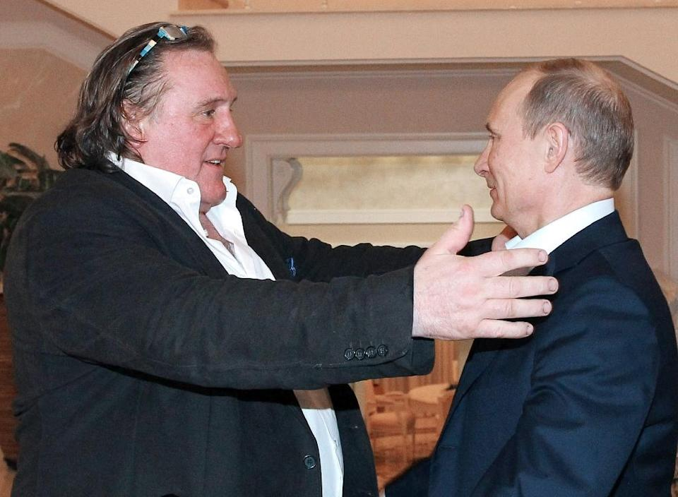 Russian President Vladimir Putin (R) greets French actor Gerard Depardieu during their meeting in Putin's residence in Sochi on January 5, 2013 (AFP Photo/Mikhail Klimentyev)