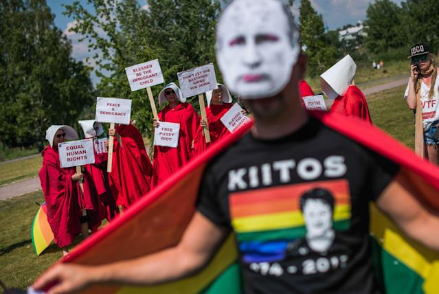 "<p>A protester wears a mask featuring a portrait of Russian President Vladimir Putin during the so-called ""Helsinki against Trump and Putin"" demonstration on July 16, 2018, in the Finnish capital Helsinki. (Photo: Jonathan Nackstrand/AFP/Getty Images) </p>"