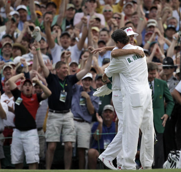Bubba Watson hugs his caddie Ted Scott after winning the Masters golf tournament following a sudden death playoff on the 10th hole Sunday, April 8, 2012, in Augusta, Ga. (AP Photo/Chris O'Meara)