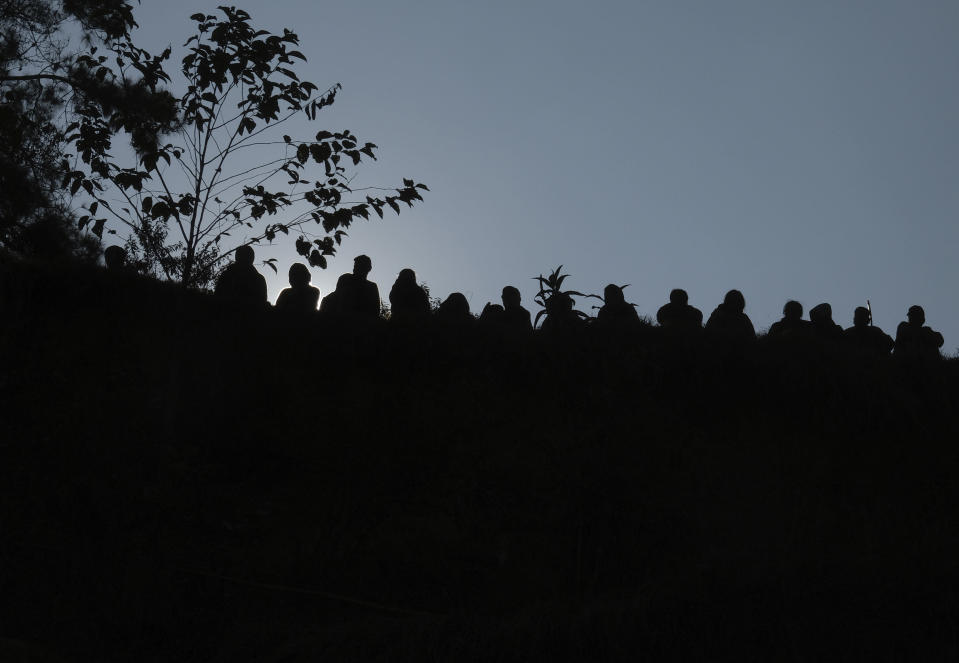 Nagas are silhouetted as they watch a friendly football match with a neighbouring village in Shangshak village, in the northeastern Indian state of Manipur, Saturday, Jan. 30 2021. Most Naga villages are perched on mountaintops, originally built long ago to spot approaching enemies when the region was little more than a forest. But on nearly every hilltop, a soccer pitch springs to life. (AP Photo/Yirmiyan Arthur)