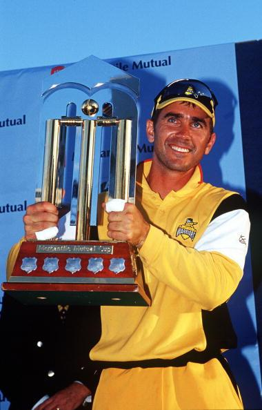 27 Feb 2000:  Justin Langer, captain of the Western Warriors holds aloft the trophy after his teams victory in the Mercantile Mutual one day final between the Western Warriors and the Queensland Bulls played at the WACA, Perth, Australia.  The Western Warriors defeated the Queensland Bulls by 45 runs. Mandatory Credit: Robert Cianflone/ALLSPORT
