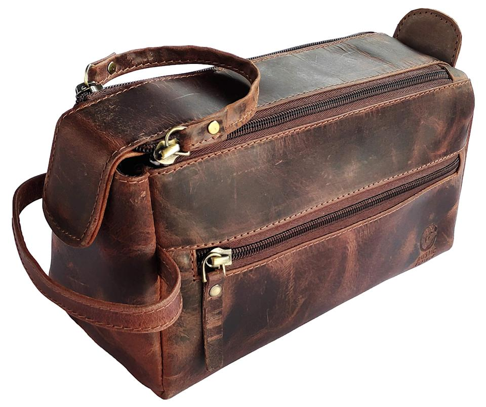 """<h2>Rustic Town Buffalo Leather Toiletry Bag</h2><br>If there's one reason to shop on Amazon, it's the fast shipping. This toiletry bag is perfect for dads ready to travel the world again, but need a little help staying organized. <br><br><em>Shop</em> <strong><em><a href=""""https://amzn.to/3ztG6nd"""" rel=""""nofollow noopener"""" target=""""_blank"""" data-ylk=""""slk:Rustic Town"""" class=""""link rapid-noclick-resp"""">Rustic Town</a></em></strong><br><br><strong>Rustic Town</strong> Rustic Town Buffalo Leather Toiletry Bag, $, available at <a href=""""https://amzn.to/3zbKXt1"""" rel=""""nofollow noopener"""" target=""""_blank"""" data-ylk=""""slk:Amazon"""" class=""""link rapid-noclick-resp"""">Amazon</a>"""