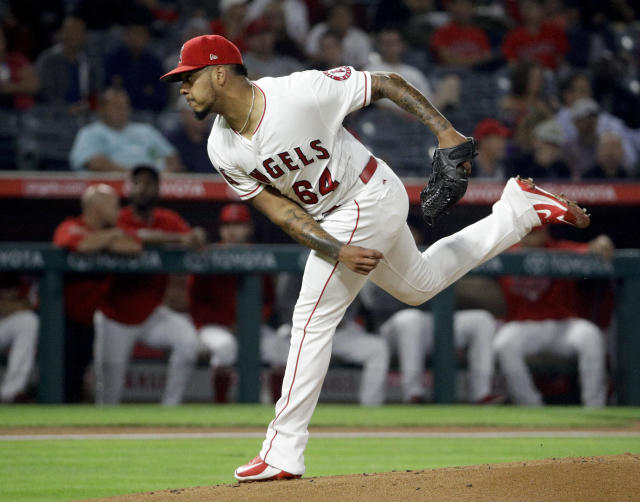 Los Angeles Angels starting pitcher Felix Pena throws against the Texas Rangers during the first inning of a baseball game in Anaheim, Calif., Monday, Sept. 24, 2018. (AP Photo/Chris Carlson)