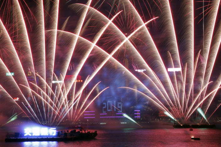 Fireworks explode over Victoria Harbor. (Photo: Kin Cheung/AP)