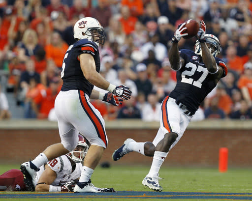 Auburn Tigers defensive back Robenson Therezie (27) intercepts a pass intended for Washington State wide receiver Brett Bartolone (19) during the first quarter of an NCAA college football game against Washington State on Saturday, Aug. 31, 2013, in Auburn, Ala. (AP Photo/Butch Dill)