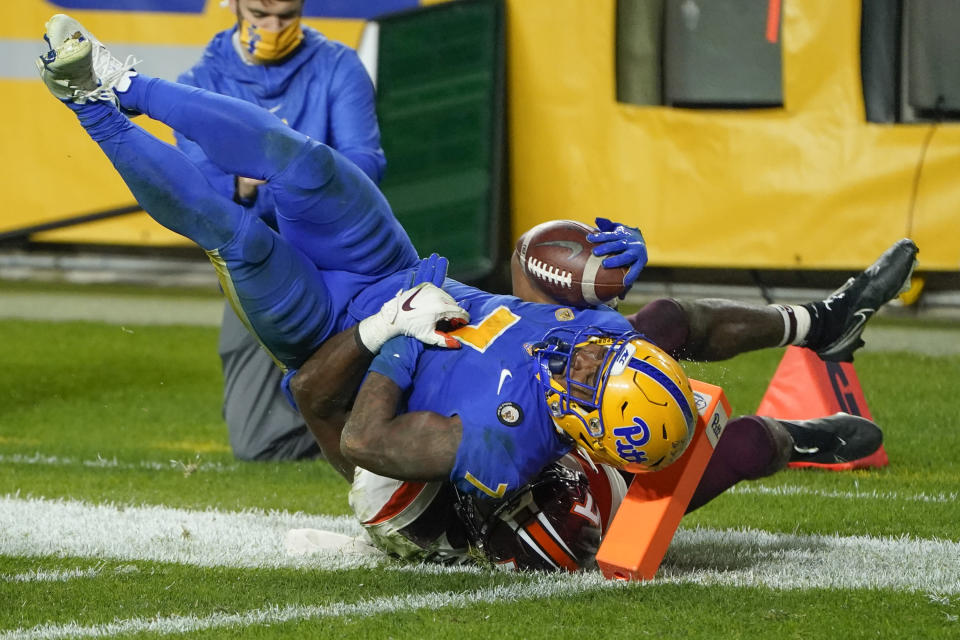 Pittsburgh wide receiver DJ Turner (7) comes up short of the end zone as he is tackled by Virginia Tech defensive back Divine Deablo (17) during the first half of an NCAA college football game, Saturday, Nov. 21, 2020, in Pittsburgh. (AP Photo/Keith Srakocic)