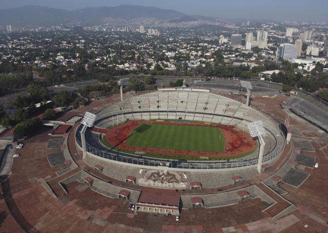 "Olimpico Universitario Stadium stands in Mexico City, Sunday, March 22, 2020. Many countries in Latin America have taken aggressive measures to deal with the new coronavirus such as closing their borders, dock and airports to foreigners. Mexico, by contrast, has so far taken a ""business as usual"" attitude. The vast majority of people recover from the COVID-19 disease. The matches of the Mexican soccer league have been suspended. (AP Photo/Eduardo Verdugo)"