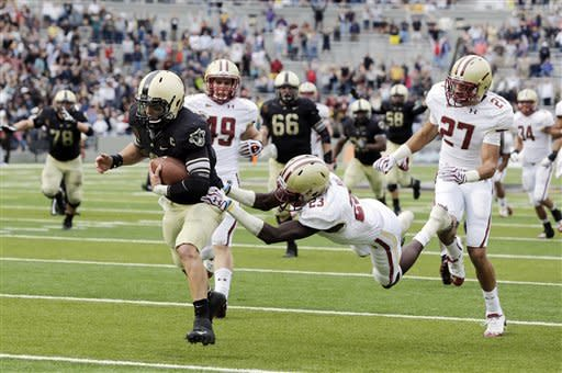Army quarterback Trent Steelman (8) eludes Boston College defensive back Jim Noel (23) to score the game-winning touchdown during the second half of an NCAA college football game Saturday, Oct. 6, 2012, in West Point, N.Y. Army won 34-31. (AP Photo/Mike Groll)