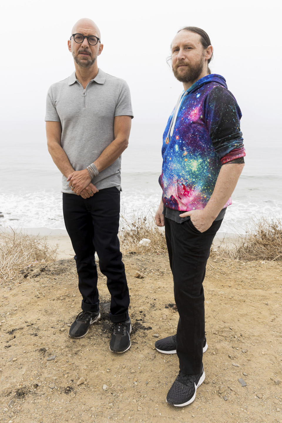 """Author Neil Strauss, left, and Incubus guitarist Mike Einziger, of the podcast """"To Live and Die in LA,"""" pose for a portrait on Thursday, June 17, 2021, in Malibu, Calif. Strauss is back with a second season of his podcast, focusing on the 2017 disappearance of Elaine Park, a 20-year-old woman last seen in Calabasas, California. (Photo by Willy Sanjuan/Invision/AP)"""