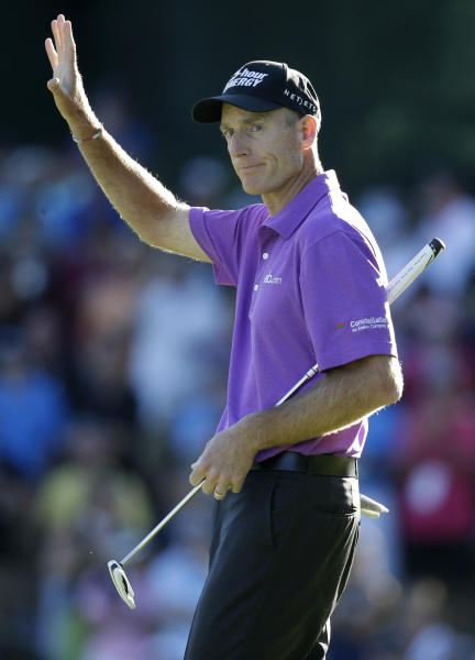 Jim Furyk celebrates after a birdie on the 18th hole during the third round of the PGA Championship golf tournament at Oak Hill Country Club, Saturday, Aug. 10, 2013, in Pittsford, N.Y. (AP Photo/Charlie Neibergall)