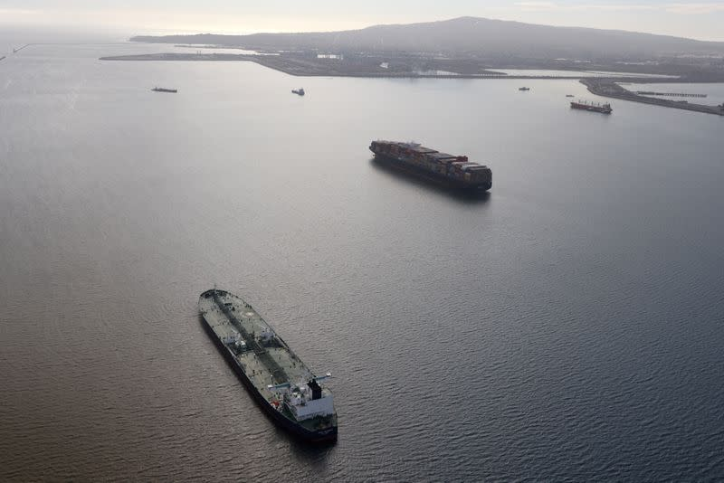 FILE PHOTO: An oil tanker waits in line in the ocean outside the Port of Long Beach-Port of Los Angeles complex, amid the coronavirus disease (COVID-19) pandemic, in Los Angeles