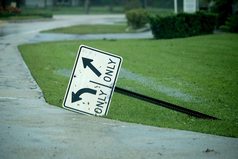 A street sign is knocked over by high winds in Coral Beach.