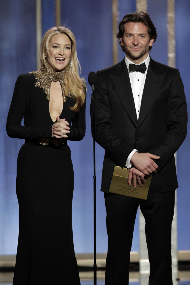 Kate Hudson and Bradley Cooper present on stage during the 70th Annual Golden Globe Awards at the Beverly Hilton on January 13, 2013 in Beverly Hills, California.