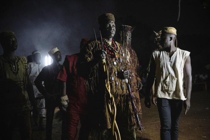Dozos, ancient hunters who have been drawn into the Islamic extremist fight, participate in a celebration of their culture in Bobo-Dioulasso, Burkina Faso, 360 kilometers (220 miles) west of the capital, Ouagadougou, on Sunday, March 28, 2021. Fighters are putting their faith in traditional spiritual practices to protect them as attacks linked to al-Qaida and the Islamic State ravage the West African nation, killing thousands and displacing more than 1 million people. (AP Photo/Sophie Garcia)