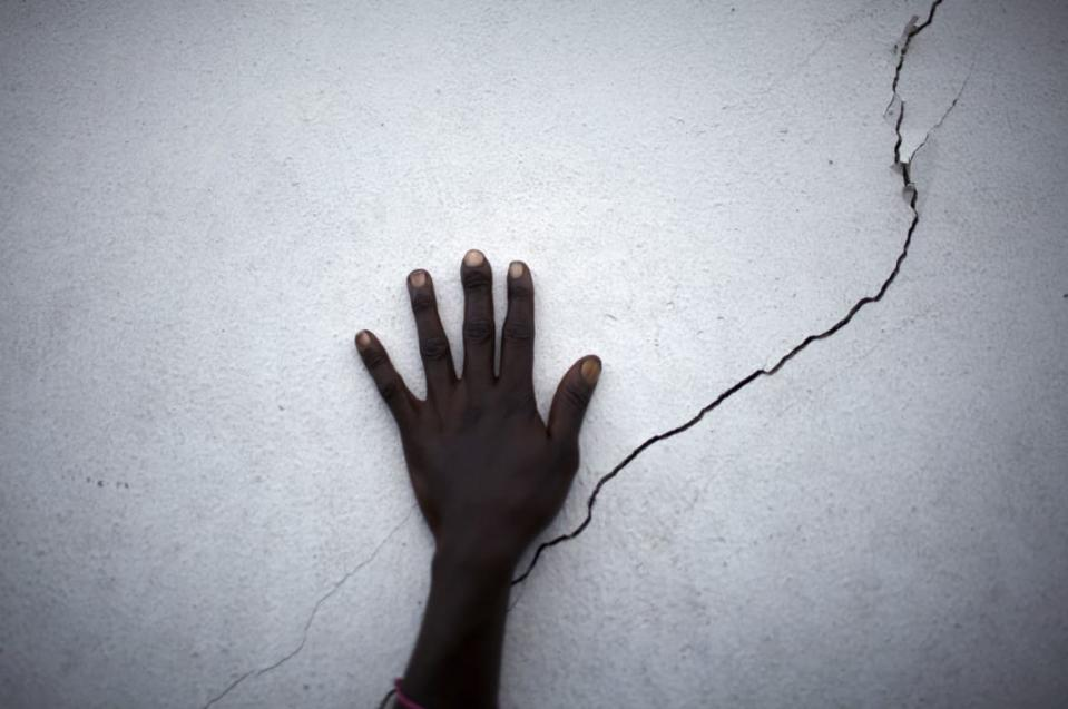 "<div class=""inline-image__caption""><p>A woman puts her hand near a crack on a wall as she waits for food distribution in Port-au-Prince, Haiti January 27, 2010. A shallow 4.9 magnitude aftershock rattled western Haiti on Tuesday, two weeks after a killer 7.0 magnitude earthquake devastated the Haitian capital, Port-au-Prince, the U.S. Geological Service said.</p></div> <div class=""inline-image__credit"">Carlos Barria/Reuters</div>"