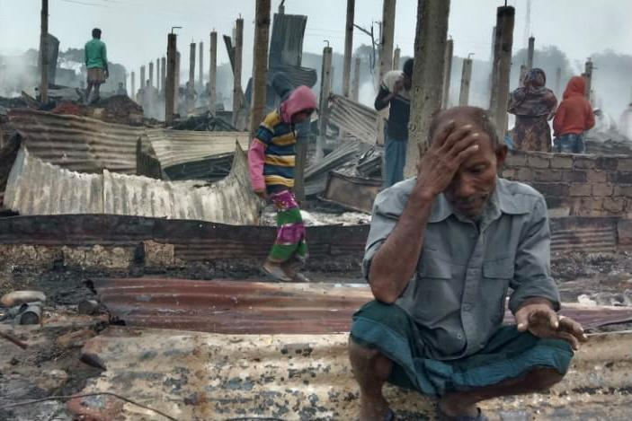 A Rohingya man reacts after a fire at the Nayapara refugee camp in Cox's Bazar