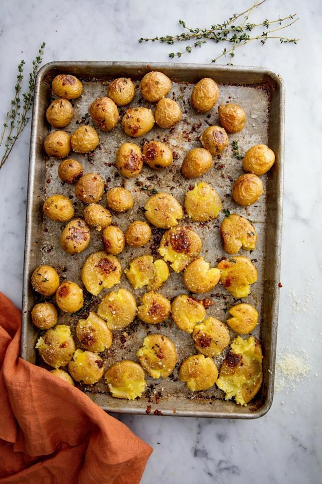 """<p>Garlic and parmesan go a long way to make these taters SO flavourful.</p><p>Get the <a href=""""http://www.delish.com/uk/cooking/recipes/a28785932/garlic-smashed-potatoes-recipe/"""" target=""""_blank"""">Garlic Smashed Potatoes</a> recipe. </p>"""