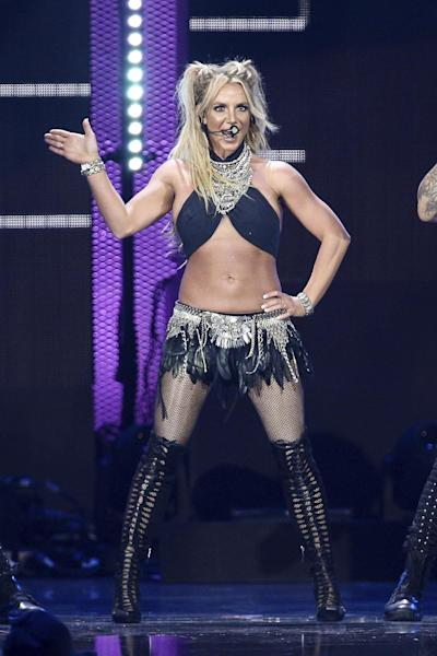 """FILE - In this Sept. 24, 2016 file photo, Britney Spears performs at the 2016 iHeartRadio Music Festival in Las Vegas. Spear, Justin Bieber and Bruno Mars are set to perform during the 12-date """"Jingle Ball"""" tour this holiday season. IHeartMedia announced Tuesday, Oct. 11, that the tour will kick off Nov. 29 in Dallas and wrap Dec. 18 in Miami. (Photo by John Salangsang/Invision/AP, File)"""