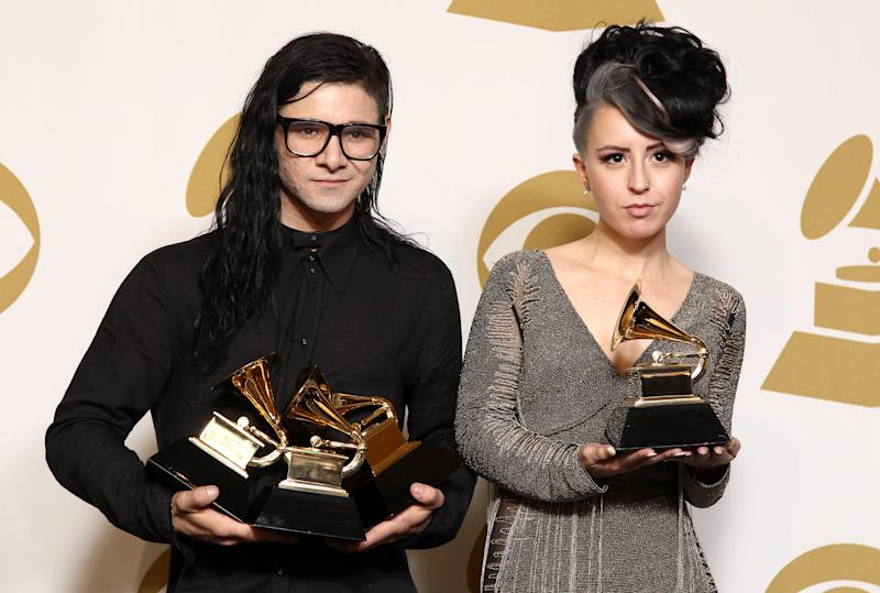 """Skrillex, left, winner of the awards for best dance/electronica album """"Bangarang,"""" best remixed recording non-classical song for """"Promises"""" and best dance recording """"Bangarang,"""" and Sirah pose backstage with the award for best dance recording """"Bangarang,"""" at the 55th annual Grammy Awards on Sunday, Feb. 10, 2013, in Los Angeles. (Photo by Matt Sayles/Invision/AP)"""