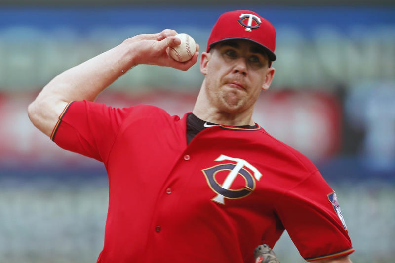 FILE - In this June 27, 2019, file photo, Minnesota Twins relief pitcher Trevor May throws against the Tampa Bay Rays during a baseball game in Minneapolis. Trevor May has been preparing for this. Not precisely for a global pandemic that would bring sports — and so much else — to an unprecedented standstill. But a break in the baseball schedule? That's something the Minnesota Twins reliever — and pro video game streamer — thought might happen eventually. (AP Photo/Jim Mone, File)
