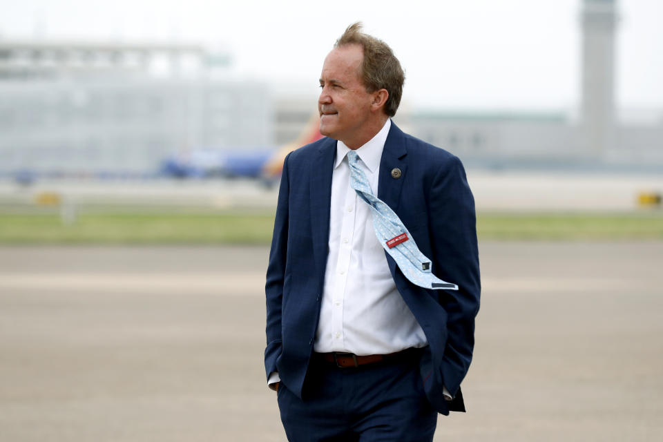 """FILE - State Attorney General Ken Paxton waits on the flight line for the arrival of Vice President Mike Pence at Love Field in Dallas, Sunday, June 28, 2020. Several top deputies of Texas' attorney general have accused him of crimes including bribery and abuse of office in an internal letter saying they've reported the actions to law enforcement. In a brief letter, seven senior lawyers wrote that they reported Paxton for potentially breaking the law """"in his official capacity as the current Attorney General of Texas."""" Paxton's defense attorney in the securities case, declined to comment on the new allegations Sunday, Oct. 4, 2020. Paxton pleaded not guilty in that case but it is not clear whether the new accusations are related. (AP Photo/Tony Gutierrez)"""